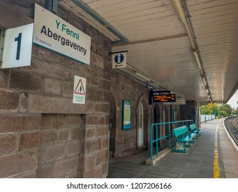 ABERGAVENNY, WALES - OCTOBER 2018: Billingual station name sign on the wall of the building on Platform 1 at Abergavenny railway station.