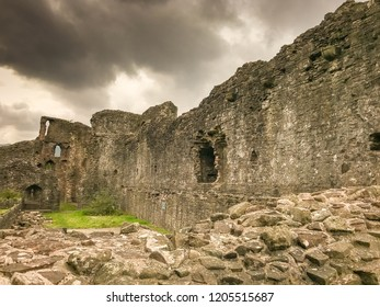 ABERGAVENNY, WALES - OCTOBER 2018: Curtain wall of Abergavenny castle looking towards the ruins of the four storey tower.