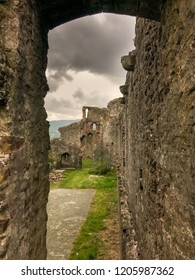 ABERGAVENNY, WALES - OCTOBER 2018: Curtain wall of Abergavenny castle looking towards the ruins of the four storey tower, with the view framed by an archway.