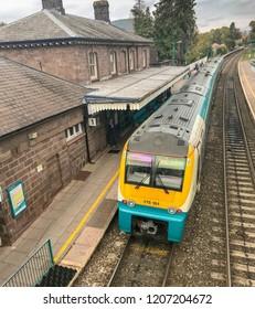 ABERGAVENNY, WALES - OCTOBER 2018: Passenger train arriving on Platform 1 in Abergavenny railway station.