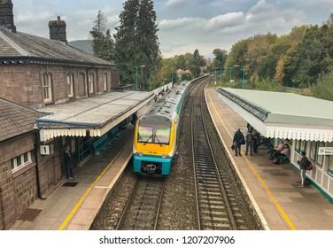 ABERGAVENNY, WALES - OCTOBER 2018: Passenger train stopped on Platform 1 in Abergavenny railway station.