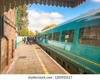 ABERGAVENNY, WALES - OCTOBER 2018: Passengers getting off a train on Platform 1 at Abergavenny railway station