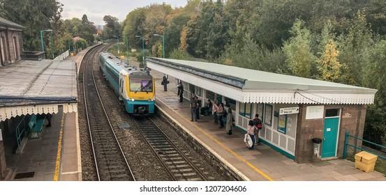 ABERGAVENNY, WALES - OCTOBER 2018: Passengers waiting as a train arrives on platform 2 at Abergavenny railway station.