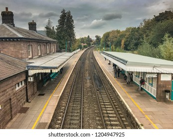 ABERGAVENNY, WALES - OCTOBER 2018: Railway station in the market town of Abergavenny, People are waiting for a train on platform 2.