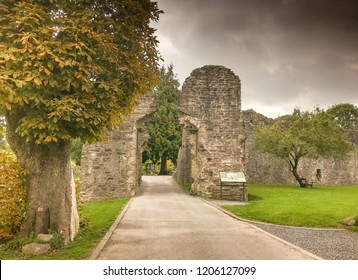 ABERGAVENNY, WALES - OCTOBER 2018: Ruins of the gatehouse in the grounds of the castle in the market town of Abergavenny.
