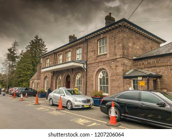 ABERGAVENNY, WALES - OCTOBER 2018: Taxi cabs parked outside the station building at Abergavenny railway station.