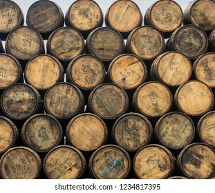 Aberlour, SCOTLAND - OCT 18, 2018: Stacked pile of wooden barrels and casks at Speyside Cooperage, home of the ancient art of coopering since 1947.