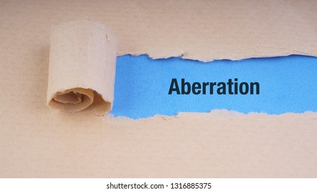 ABERRATION text on brown envelope and torn paper. Concept Image