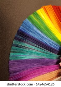Aberrations.Rainbow palette of colors. Multicolored strands. A beautiful combination of colors in wigs.