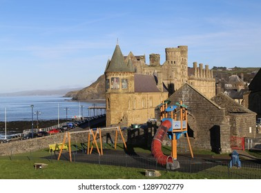Aberystwyth, Ceredigion, Wales,  January 9, 2019. A coastal view across the town with the Old College building and a colorful children's playground.