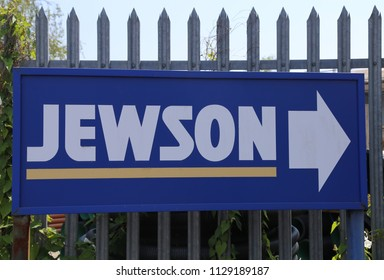 Aberystwyth, Ceredigion, Wales, UK.  5 July 2018.  A Jewson builders merchant sign with arrow indicating the way to the shop.