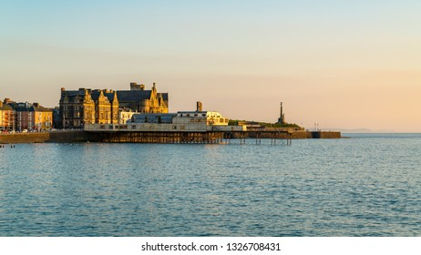 Aberystwyth, Ceredigion, Wales, UK - May 25, 2017: Evening view over the beach, the pier and the old University College