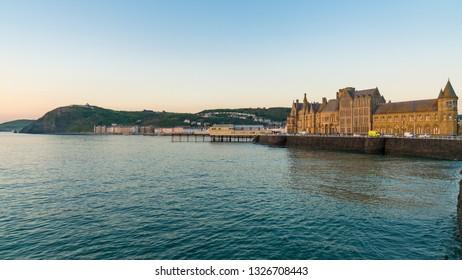 Aberystwyth, Ceredigion, Wales, UK - May 25, 2017: Evening view over the Marine Terrace with Yr Hen Goleg (Aberystwyth University Old College) on the right