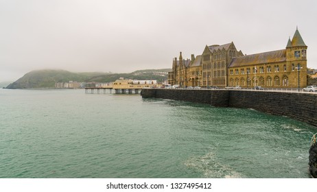 Aberystwyth, Ceredigion, Wales, UK - May 24, 2017: View over the Marine Terrace with Yr Hen Goleg (Aberystwyth University Old College) on the right
