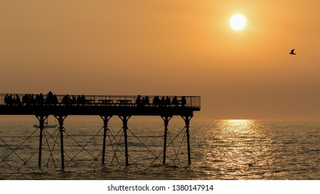 Aberystwyth Seafront on the coast to the Irish Sea with pier at sunset.