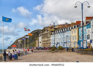 ABERYSTWYTH, WALES, UNITED KINGDOM - AUGUST 20, 2016: The North beach and marine terrace taken from the Royal Pier at Aberystwyth in Wales.