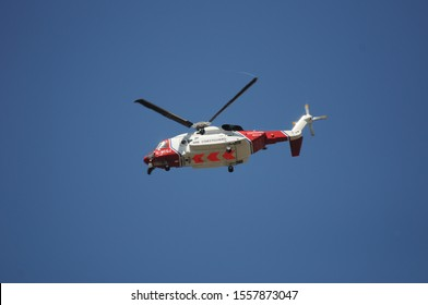 Aberystwyth Wales/UK June 21 2018: HM Coastguard Helicopter G-MCGJ flying overhead with the wheels down - Sikorsky S92s - based at Caernarfon Wales operated by Bristow Helicopters ltd