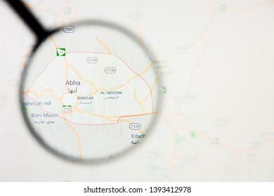 Abha city in Saudi Arabia visualization illustrative concept on display screen through magnifying glass