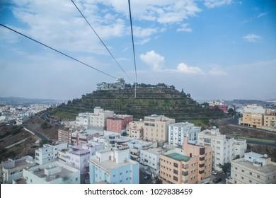 Abha green mountain cable car aerial saudi arabia city skyline cityscape landscape
