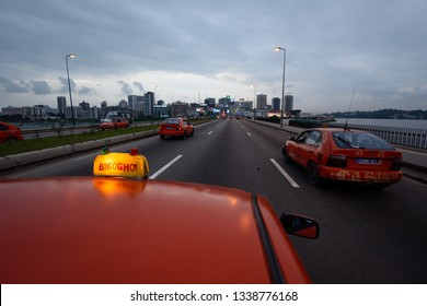 Abidjan, Cote d'Ivoire - 06/23/2014: The skyline at dusk from an approaching taxi