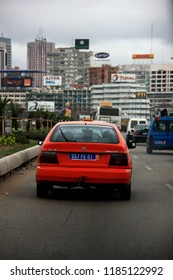 Abidjan, Cote d'Ivoire - October 1st, 2012: Red car on the way to downtown Abidjan