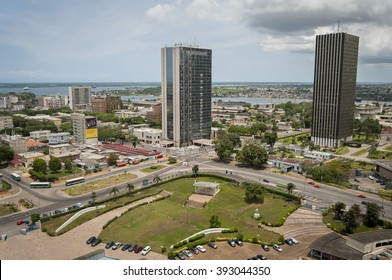 ABIDJAN, IVORY COAST, AFRICA. April 2013. Abidjan, the economical capital of Ivory Coast (Cote d'Ivoire), its business area Plateau with the Atlantic ocean bay in the background. Abidjan stock Image.