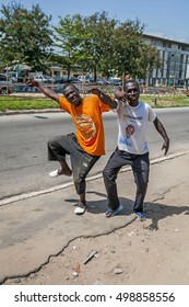 ABIDJAN, IVORY COAST, AFRICA. May 3, 2013. Two young African man hamming, joking fooling around. African people stock image.