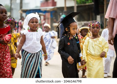 Abidjan, Ivory Coast - February 13, 2018: Unidentified children dressed in different styles, walk on the street during a festive ceremony of children.