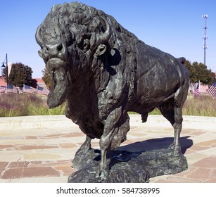 Abilene, TX USA November 9, 2014: Tribute to the American Bison and veterans is displayed with a bronze sculpture of a Bison ringed by American flags, in front of the Abilene, Texas Visitor Center