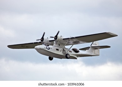 ABINGDON, ENGLAND - MAY 6: A Consolidated PBY Catalina seaplane gives a low level flypast to the public at the Abingdon airshow on May 6, 2012 at Abingdon