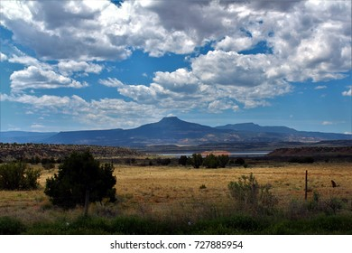 Abiquiu, New Mexico - May 7, 2017: Distant Pedernal Mountain beneath cloudscape.
