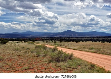 Abiquiu, New Mexico - May 7, 2017: Dirt road with Pedernal Mountain in the distance, Ghost Ranch.