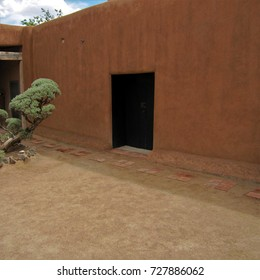Abiquiu, New Mexico - May 7, 2017: Black door in adobe wall, Georgia O'Keeffe Home and Studio.