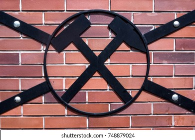 Ablack  symbol of mining and brick background