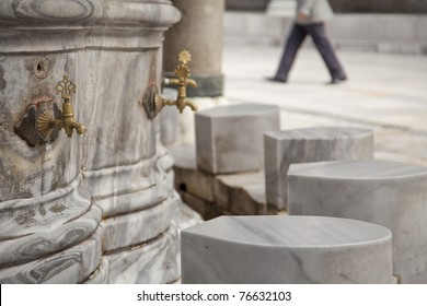 Ablution taps where worshippers wash their feet before prayer time. Beayazit mosque, Istanbul, Turkey.