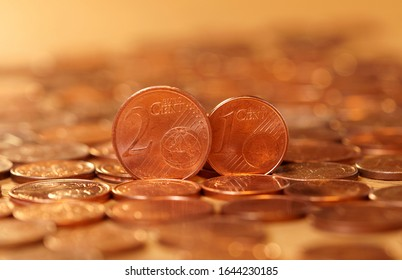 Abolition of one and two cent euro coins. Europeans in favour of abolishing 1 cent and 2 cent coins. Euro currency coin. coins background. Income and profits. Banking, economics, saving money.