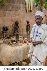 Abomey, Benin - March 07, 2014: African voodoo fetish priest performing ritual at outdoor vodoo shrine