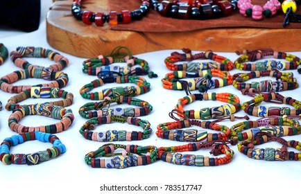 Aboriginal handmade jewelry and bracelets with colorful glass beads for sale at a market