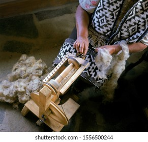 Aboriginal Mapuche woman works with her loom to sell her crafts