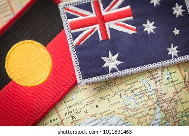 Aboryginal and Australian flag on the map of Australia