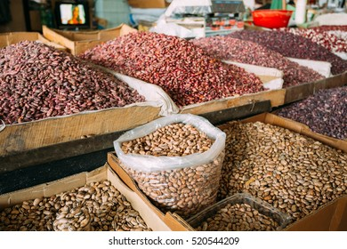 The Abounding Market Bazaar Showcase With Wide Range Of Varicolored Sorts Of Raw Dry Beans In Bulk In Trays For Sale.