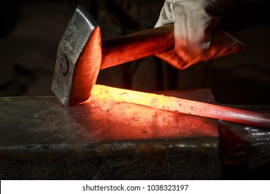 About artistic Forging of Metal. Blacksmithing. Pattern and forms for the artist blacksmith. Treatment of molten metal close-up. Handmade blacksmith.