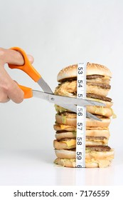 About to cut the tape measure wrapped around a burger