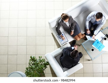 Above angle of three associates interacting at meeting