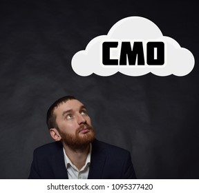 Above the businessman hangs a cloud with the inscription:CMO