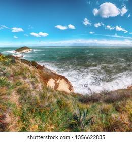 Above the cliffs at the coastline of Vieste. Summer rocky sea coast Baia Di Campi Vieste on the Gargano peninsula, Puglia, Italy