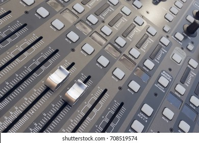 From above close-up of gray colored professional audio mixing board.