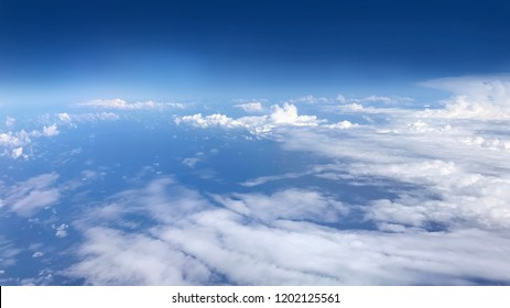 above of cloud with blue sky, top of cloudy atmosphere, aerial view of cloudscape
