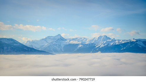 Above the cloud inversion, Monument Mountain and the Purcell Mountains, British Columbia, Canada