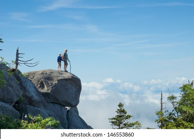 Above the clouds. Father and son on a rock in the National Park Great Smoky Mountains
